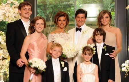 Nick and Dominique at their wedding along with their children