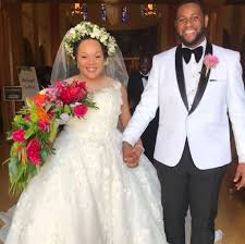 Yamiche holding Nathaniel's hand during their marriage.