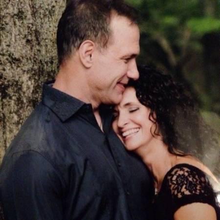 Carrie Yocom, along with her husband, Chris Speilman